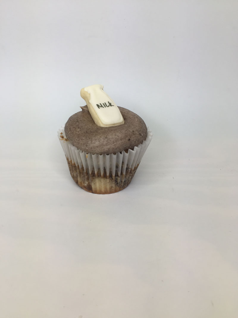 Cookies and cream milk topper cupcake